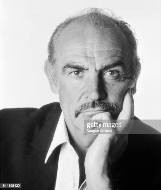 Portrait of actor Sean Connery leaning on his hand in 1983