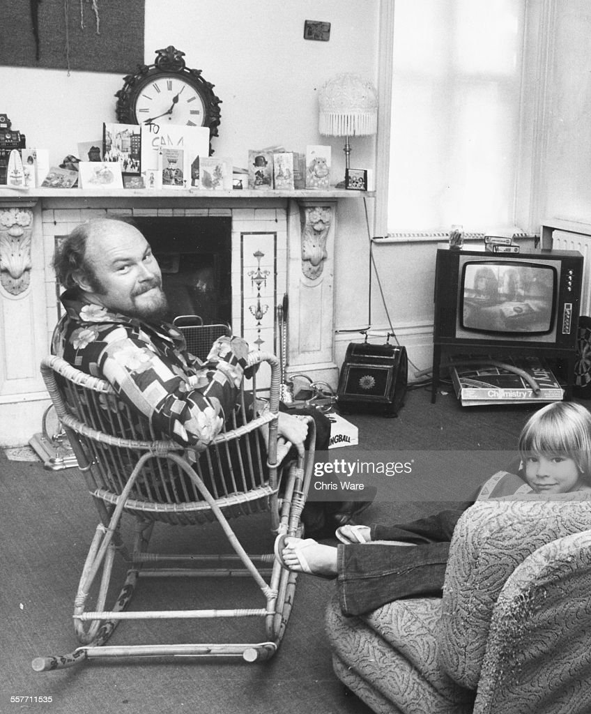 Portrait of actor Timothy West and his son Joseph watching television in their home in Wandsworth Common London circa 1975