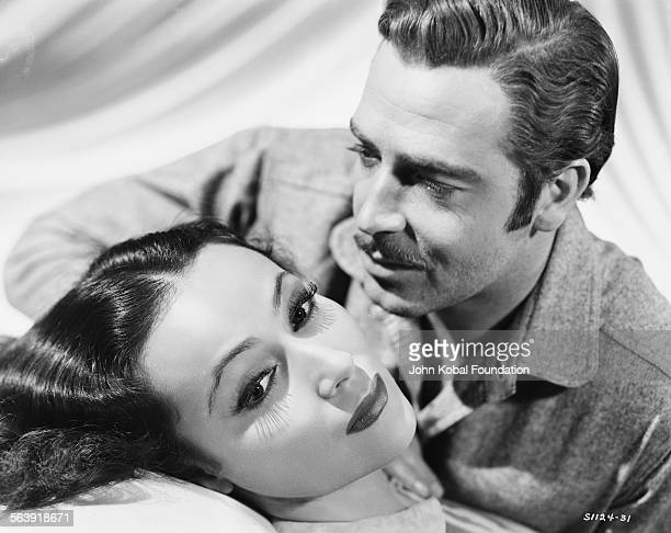 Portrait of actors Dolores del Rio and John Howard as they appear in the film 'The Man from Dakota' for MGM Studios 1940
