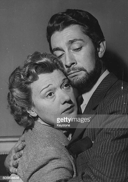 Portrait of actors JeanClaude Pascal and Edwige Feuillere in an embrace as they appear in the Alexandre Dumas play 'La Dame Aux Camelias' September...