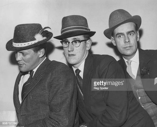 Portrait of actors Peter Dobson Dudley Williams and Ian Carmichael acting as models for a series of 'Delta' hats at the Hatters Information Centre at...