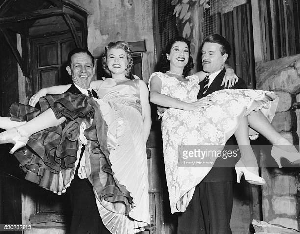 Portrait of actors Sidney James and Dennis Bowen carrying actresses Shani Wallis and Pat Kirkwood during rehearsals for the play 'Wonderful Town' at...