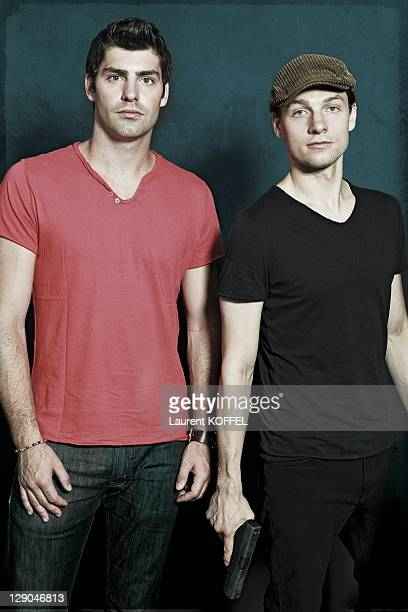 Portrait of actors Travis Milne and Gregory Smith of the Canadian police drama television serie 'Rookie Blue' on June 27 2011 in Paris France