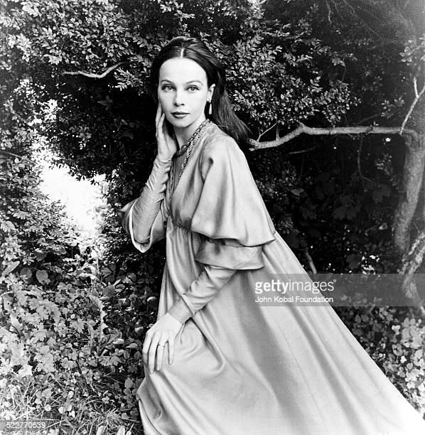 Portrait of actress and dancer Leslie Caron standing in a garden with MGM Studios October 6th 1958