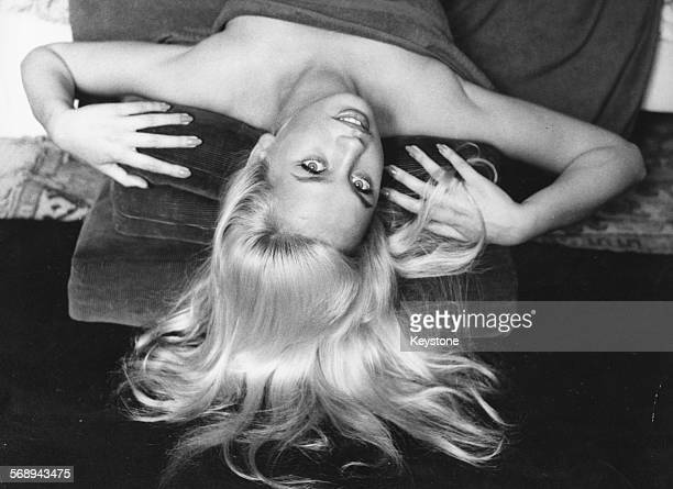 Portrait of actress Barbara Valentin reclining back with her hair fanned out Munich September 23rd 1959