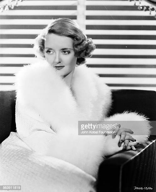 Portrait of actress Bette Davis wearing a furtrimmed robe for Warner Bros Studios 1931