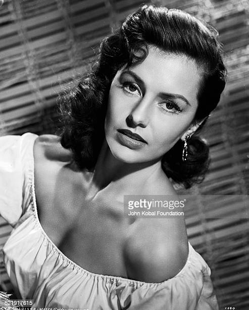 Portrait of actress Cyd Charisse wearing an off the shoulder blouse for MGM Studios August 14th 1952