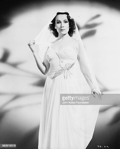 Portrait of actress Dolores del Rio wearing a dress and veil for Warner Bros Pictures 1935