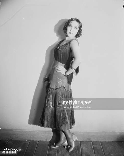 Portrait of actress Dolores del Rio wearing a fringed dress for MGM Studios 1927