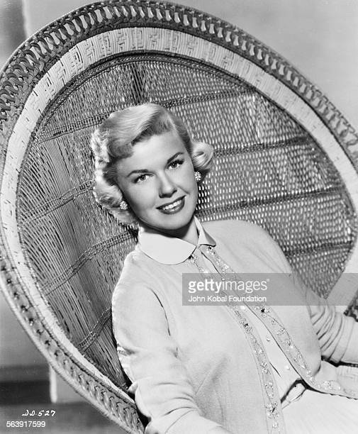 Portrait of actress Doris Day sitting in a wicker chair for Warner Bros Studios 1951