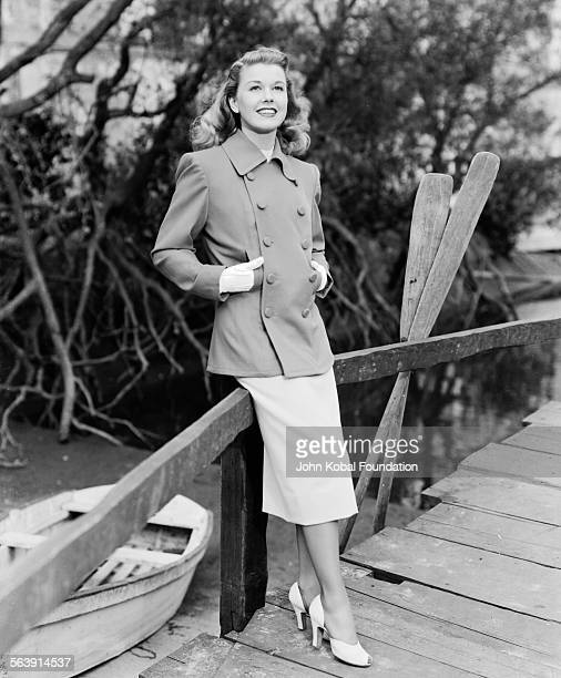 Portrait of actress Doris Day standing on a bridge over a stream for Warner Bros Studios 1951