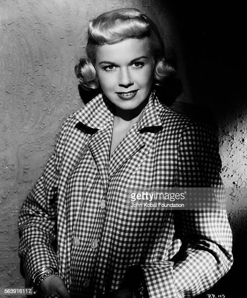 Portrait of actress Doris Day wearing a check jacket for Warner Bros Studios 1951