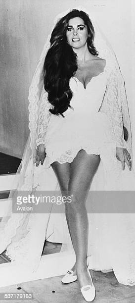 Portrait of actress Edy Williams wearing a short wedding dress as she appears in the movie 'Return of the Valley of the Dolls' August 19th 1970