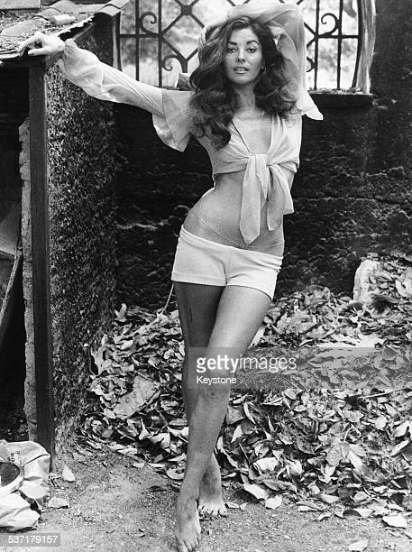 Portrait of actress Edy Williams wearing shorts and a crop top outdoors in Rome Italy circa 1970