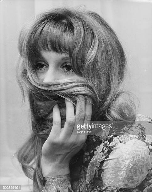 Portrait of actress Francoise Dorleac holding her hair to her face at a press conference for her new film 'Passport to Oblivion' Connaught Hotel...