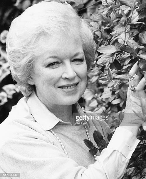 Portrait of actress June Whitfield in the garden of her home in Wimbledon England circa 1975