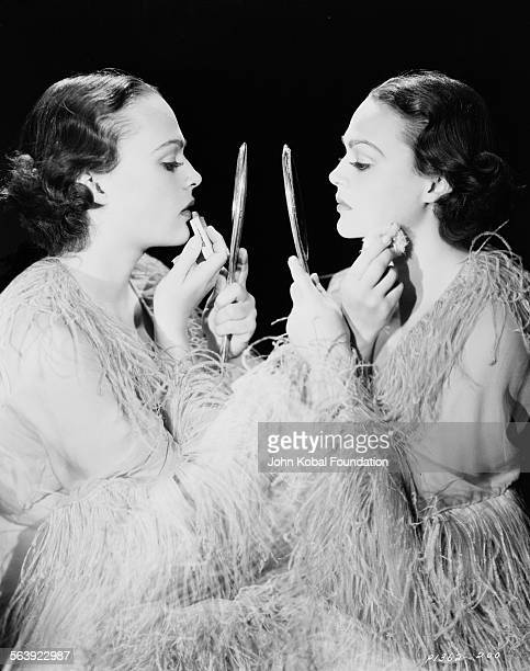 Portrait of actress Katherine DeMille applying makeup in a mirror daughter of famous filmmaker Cecil B DeMille for Paramount Pictures 1935