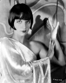 Portrait of actress Louise Brooks wearing a oneshoulder dress for Paramount Pictures 1929