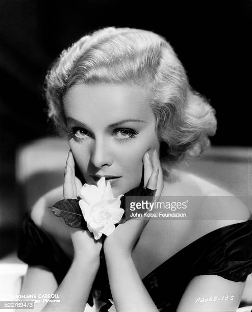 Portrait of actress Madeleine Carroll holding a flower with Paramount Pictures 1935