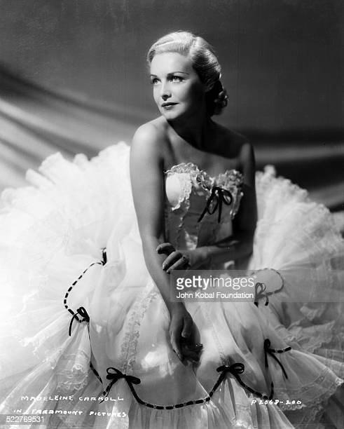Portrait of actress Madeleine Carroll surrounded by the petticoats of her dress with Paramount Pictures 1938
