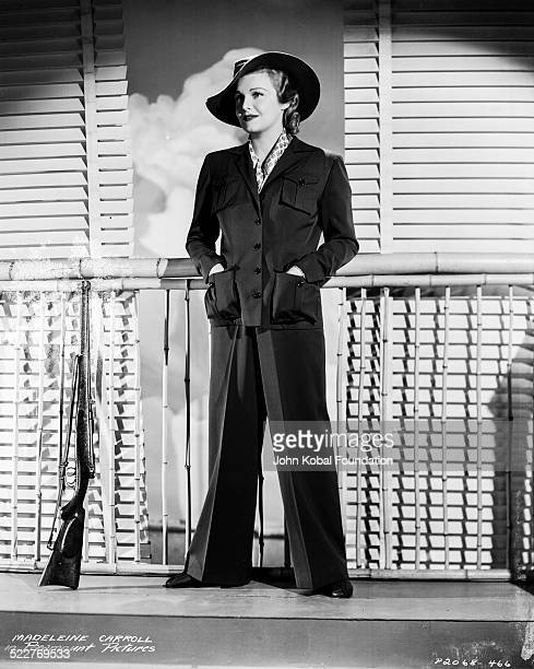 Portrait of actress Madeleine Carroll wearing a trouser suit and hat with Paramount Pictures 1938