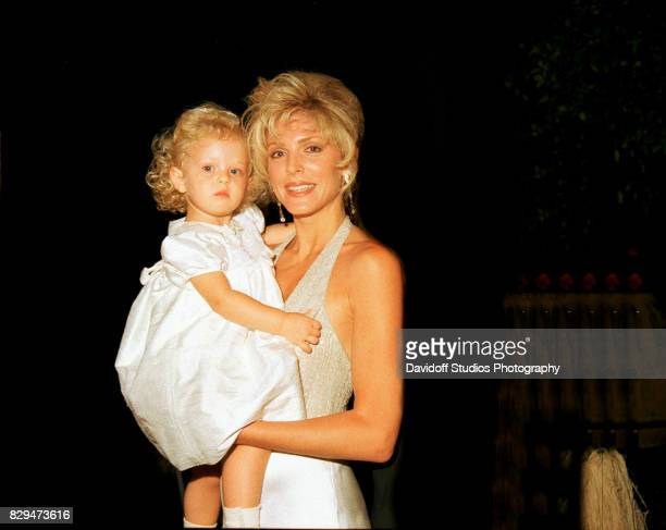 Portrait of actress Marla Maples as she holds her daughter Tiffany during the official opening party of the MaraLago Club