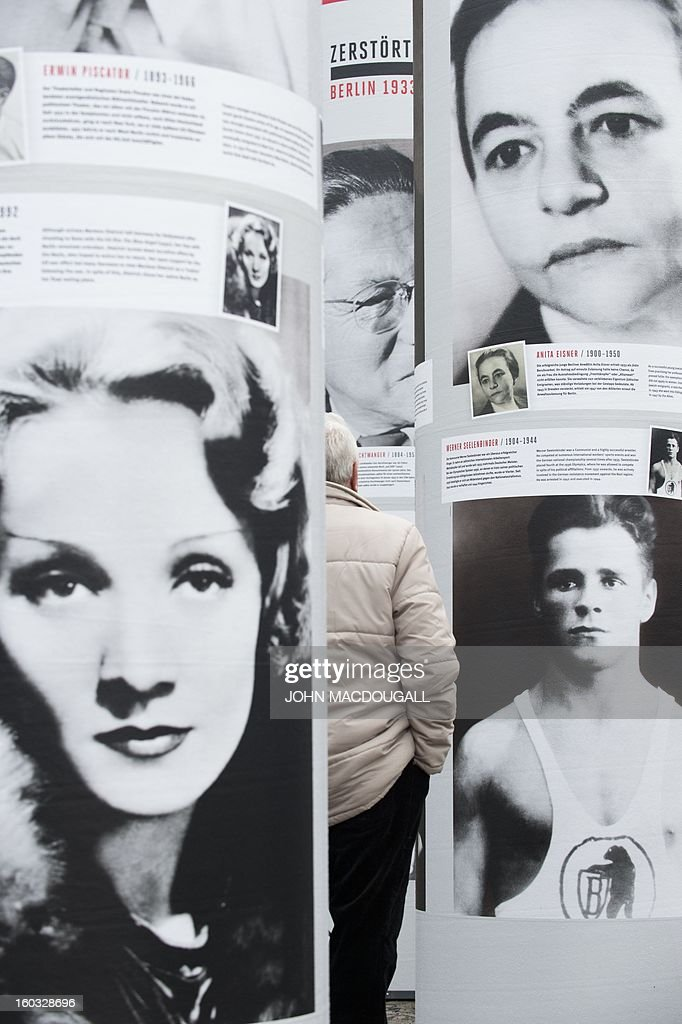 A portrait of actress Marlene Dietrich (L) appears in the 'Diversity Destroyed, Berlin 1933, 1938, 1945' outdoor exhibition in front of Berlin's Brandenburg Gate January 29, 2013. Featuring portraits of prominent members of the German capital's intellectual, artistic and cultural landscape who were affected by Nazi politics and terror, the exhibition coincides with the 80th anniversary of Adolf Hitler's accession to power January 30, 1933.