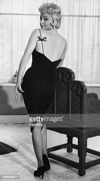 Portrait of actress Nadja Tiller wearing a revealing dress promoting the film 'The Rough and the Smooth' London March 20th 1959