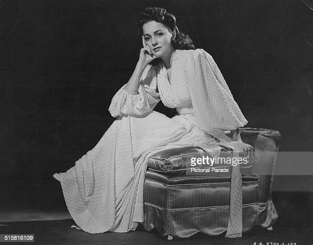 Portrait of actress Olivia de Havilland wearing a chenille crepe dress as she appears in the movie 'Raffles' 1939