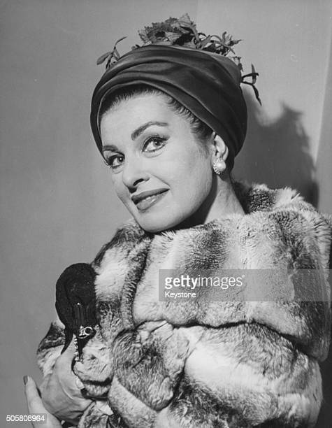 Portrait of actress Silvana Pampanini wearing a fur coat and head scarf attending a performance of the play 'Porgy and Bess' in Rome March 30th 1962