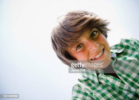 Portrait of adolescent boy, shot from below : Stock Photo