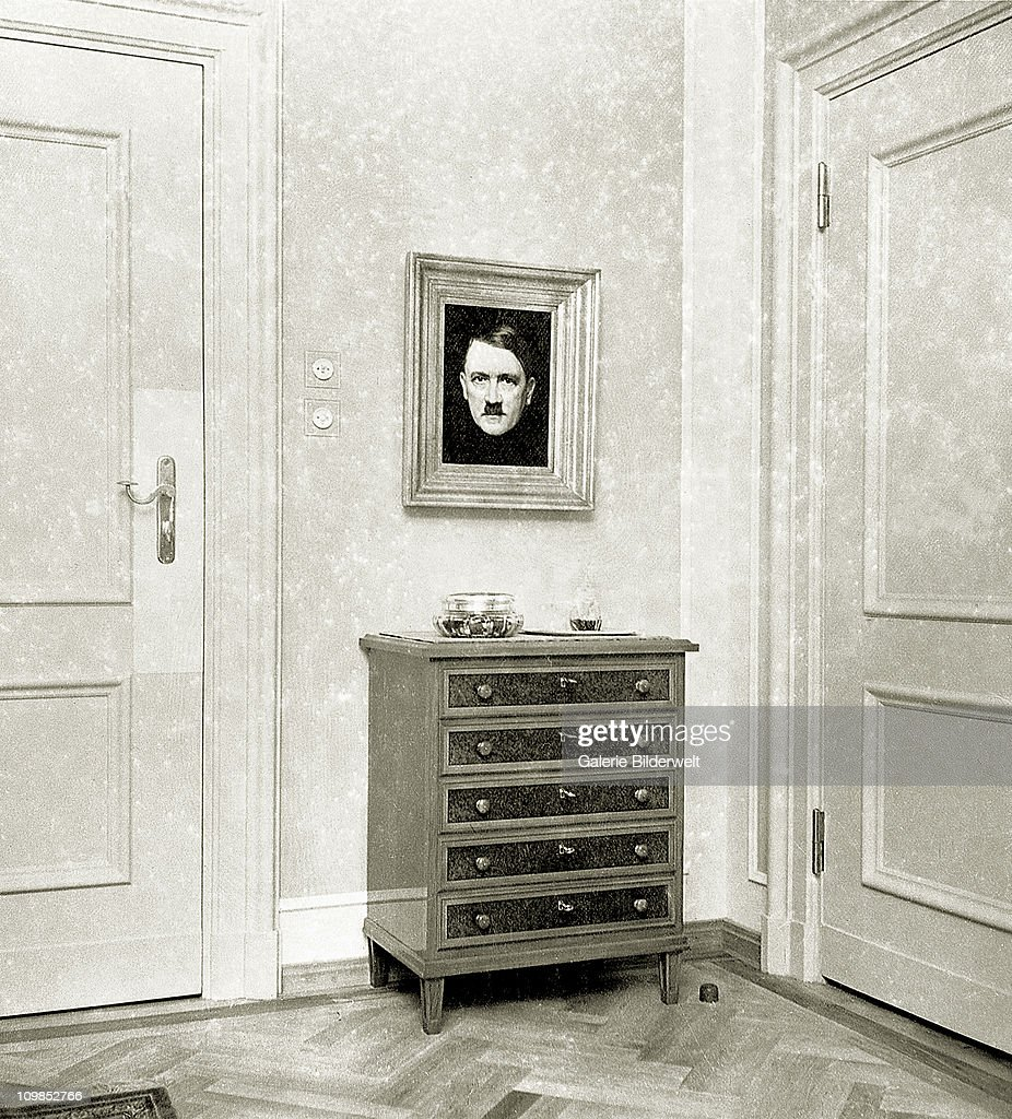 A portrait of Adolf Hitler in Eva Braun's living room at the Berghof near Berchtesgaden, Germany, 1937. Braun's rooms connected with Hitler's. She started a relationship with Adolf Hitler in 1931 and moved into his residency in 1936.