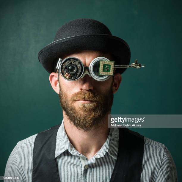 Portrait Of Adult Man Wearing A Bowler Hat And Handmade Smartglasses