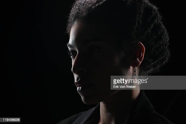 Portrait of adult on black background