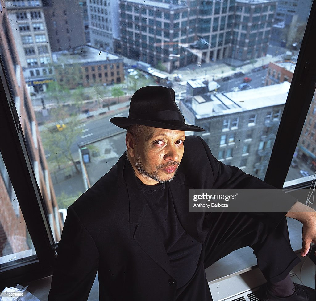 Portrait of African American mystery writer Walter Mosley, posed against a window, overlooking a New York city street, 2001.