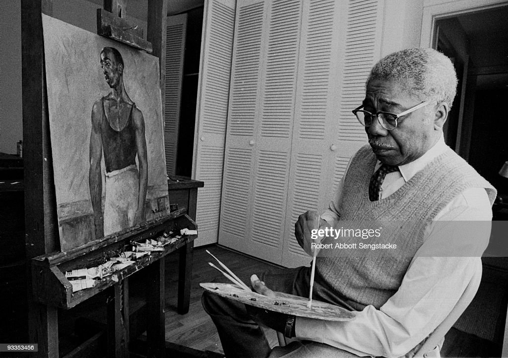 Portrait of African American painter <a gi-track='captionPersonalityLinkClicked' href=/galleries/search?phrase=Aaron+Douglas+-+Painter&family=editorial&specificpeople=13845473 ng-click='$event.stopPropagation()'>Aaron Douglas</a> (1899 - 1979), long time professor at Fisk University, and a leading figure in the Harlem Renaissance, painting at his easel, Tennessee, ca.1970s.