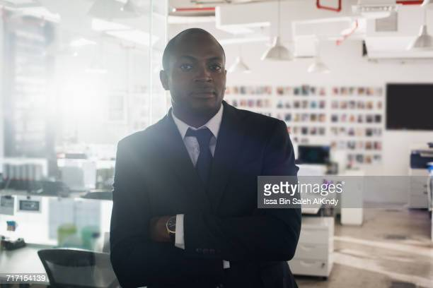 Portrait of African businessman with arms crossed