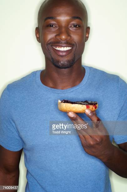 Portrait of African man eating bagel