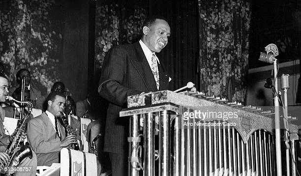 Portrait of AfricanAmerican jazz vibraphonist pianist percussionist bandleader and actor Lionel Hampton playing the vibraphone Washington DC 1955