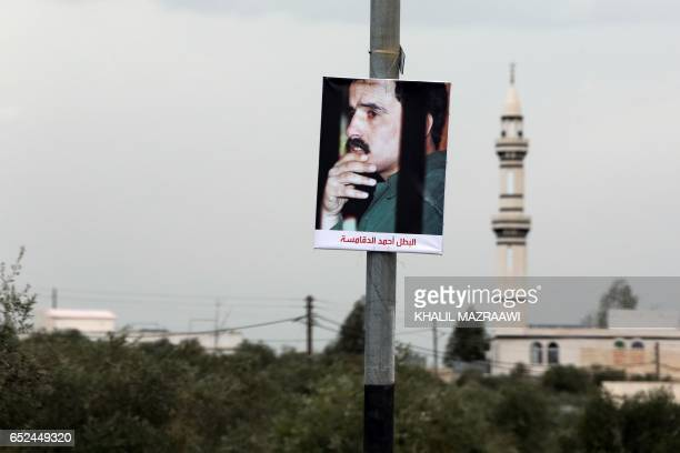 A portrait of Ahmad Dakamseh is seen hanging on a post in Irbid 90 kilometres north of the capital Amman on March 12 upon Ahmad's release after...