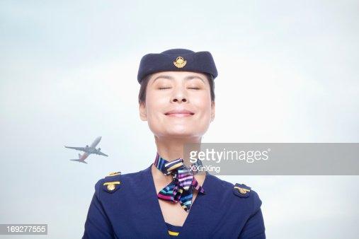 Portrait of air stewardess, eyes closed