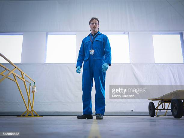 Portrait of aircraft engineer in aircraft maintenance factory
