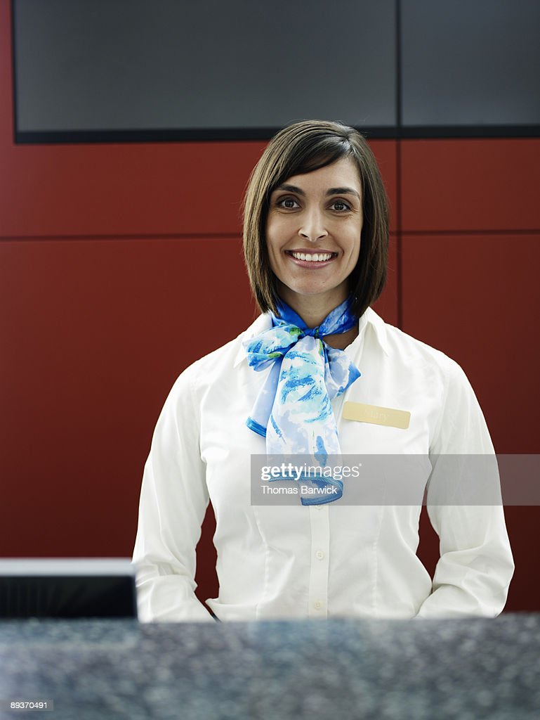 Portrait of airline ticket agent behind counter
