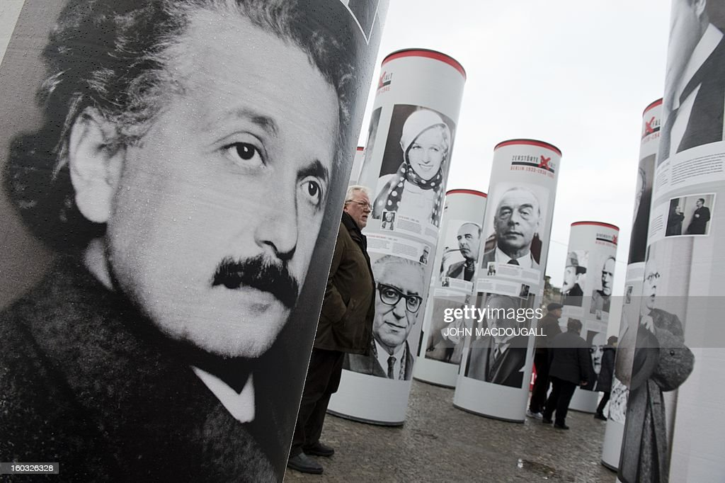 A portrait of Albert Einstein appears in the 'Diversity Destroyed, Berlin 1933, 1938, 1945' outdoor exhibition in front of Berlin's Brandenburg Gate January 29, 2013. Featuring portraits of prominent members of the German capital's intellectual, artistic and cultural landscape who were affected by Nazi politics and terror, the exhibition coincides with the 80th anniversary of Adolf Hitler's accession to power January 30, 1933. AFP PHOTO / JOHN MACDOUGALL