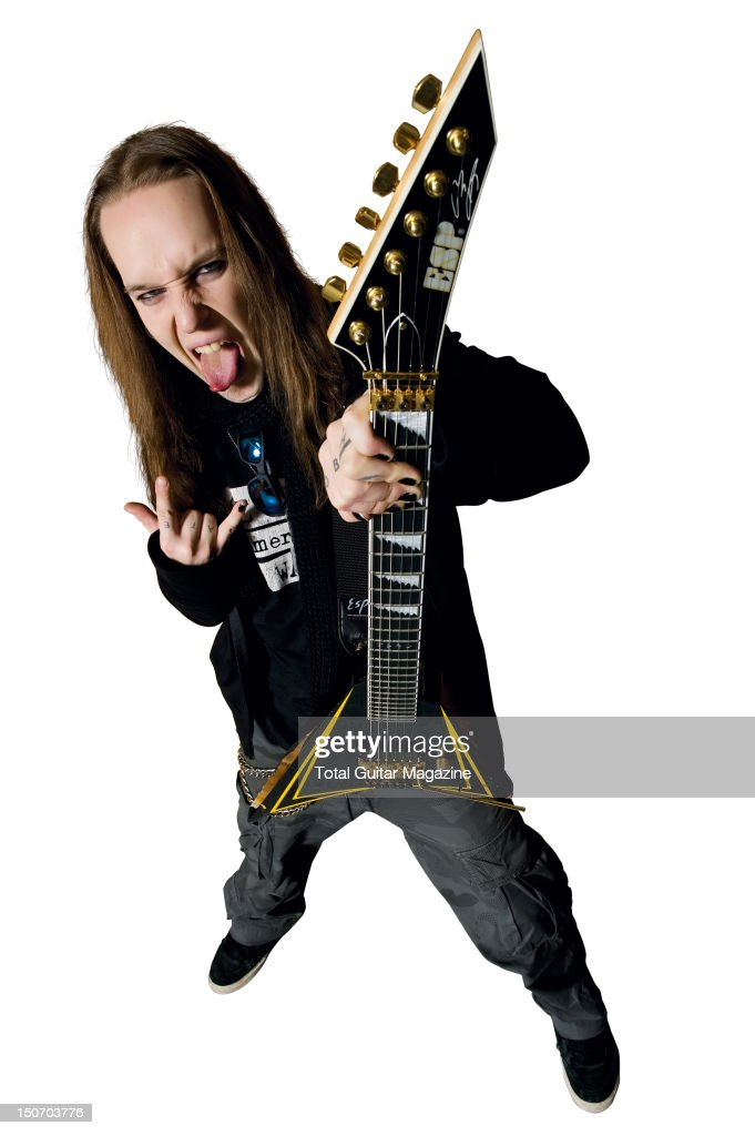 Portrait of Alexi Laiho frontman with Finnish death metal group Children of Bodom posing with one of his signature ESP guitars taken on November 8...