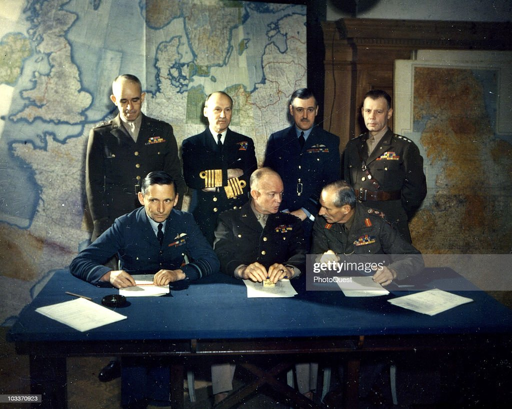 Portrait of Allied military commaders as they pose around a table, England, Spring, 1944. Pictured are, sitting from left, British Air Chief Marshal Sir <a gi-track='captionPersonalityLinkClicked' href=/galleries/search?phrase=Arthur+Tedder&family=editorial&specificpeople=214189 ng-click='$event.stopPropagation()'>Arthur Tedder</a> (1890 - 1967), American General (and future US President) Dwight D. Eisenhower (1890 - 1969), and British General Bernard Montgomery (1887 - 1976); standing, from left, American Lieutenant General <a gi-track='captionPersonalityLinkClicked' href=/galleries/search?phrase=Omar+Bradley&family=editorial&specificpeople=93901 ng-click='$event.stopPropagation()'>Omar Bradley</a> (1893 - 1981), British Admiral Sir Bertram Ramsay (1883 - 1945), British Air Chief Marshal Sir Trafford Leigh-Mallory (1892 - 1944), and Lieutenant General Walter Bedell Smith (1895 - 1961).