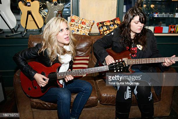 Portrait of Allison Robertson and Maya Ford of American rock group The Donnas in a guitar shop in London taken on November 1 2007