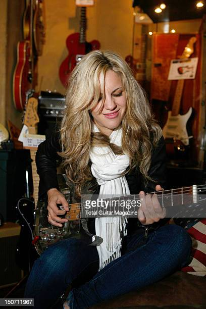 Portrait of Allison Robertson guitarist with American rock group The Donnas in a guitar shop in London taken on November 1 2007