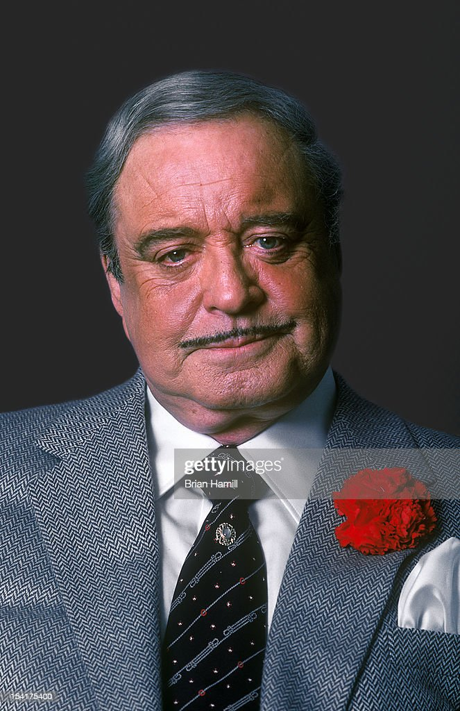 Portrait of American actor and comedian <a gi-track='captionPersonalityLinkClicked' href=/galleries/search?phrase=Jackie+Gleason&family=editorial&specificpeople=203285 ng-click='$event.stopPropagation()'>Jackie Gleason</a> (1916 - 1987) in a grey suit with a red carnation in jacket lapel, New York, New York, July 1985.