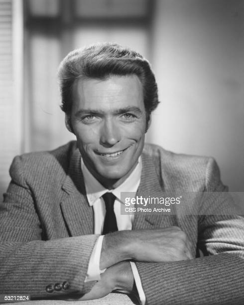 Portrait of American actor Clint Eastwood smiling and wearing a suit and tie 1961